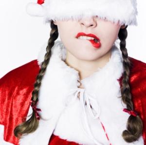 Lady in Christmas Hat looking worried
